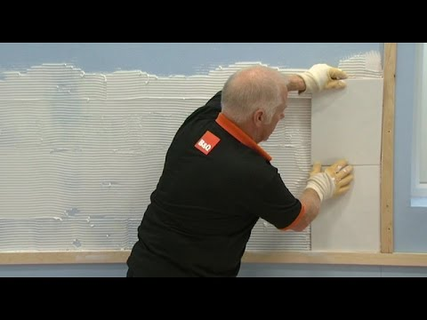How to Tile a Wall Apply your adhesive to the wall. Place your tiles on the wall