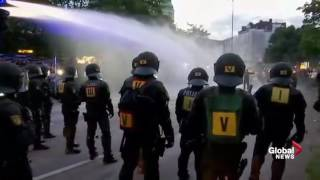 Police scuffle, fire water cannons at G20 protesters in Hamburg, Germany