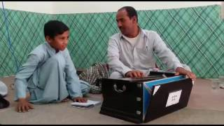A baloch child Sing sing Urdu gazal