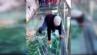 Tourist terrified by new glass walkway that cracks under weight