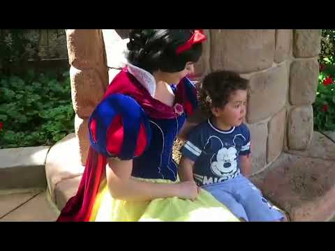 Snow White calmly appeases my son at Disney World
