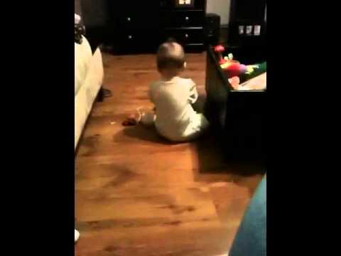 Edan plays on floor