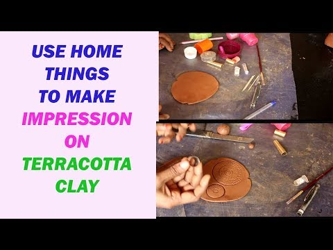 Use home  thing to make impression  on terracotta clay / impression on clay