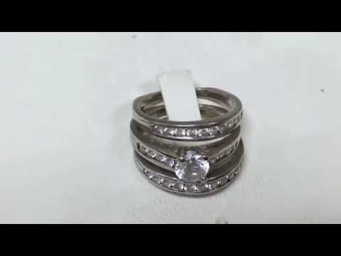 Before and after of a repaired cubic zirconia ring in 14k white gold