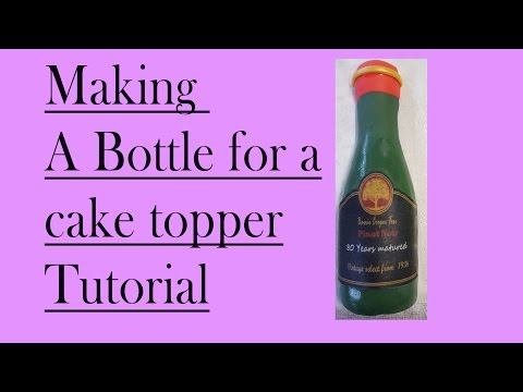 making a chocolate and fondant bottle cake topper