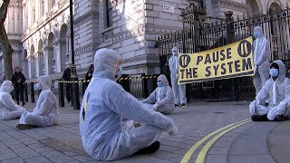 Coronavirus protesters demonstrate outside Downing street to demand more action from the government