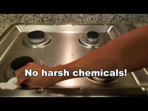 Cleaning baked in grease and grime from a stainless steel range top with natural cleaners