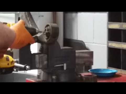Removing a control arm bushing using a drill bit