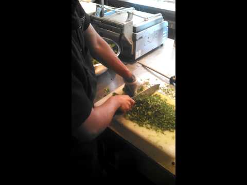 Cutting cilantro by D