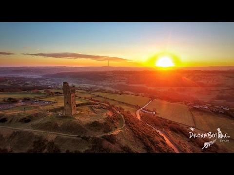 Sunrise at CastleHill, Huddersfield, West Yorkshire, England by DroneBoy Inc.