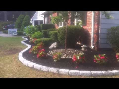 Techo-bloc walls, steps and cobblestone borders with landscape design and plantings