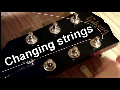 How To Change Strings On An Electric Guitar - How To Put New Strings (re string a guitar)