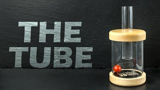 The tube puzzle. Do you know how to take the ball out?