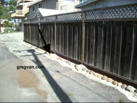 Water Diverter Under Fence In Alley - How To Keep Water Out Of Your Backyard