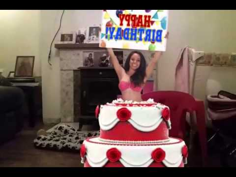 Woman jumps out of a cake