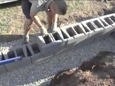 Do it yourself video -How to build your own retaining wall for your home or business