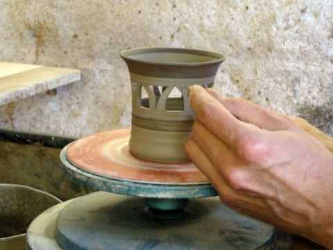 Ingleton Pottery Making and carving a small clay pottery pierced candle holder