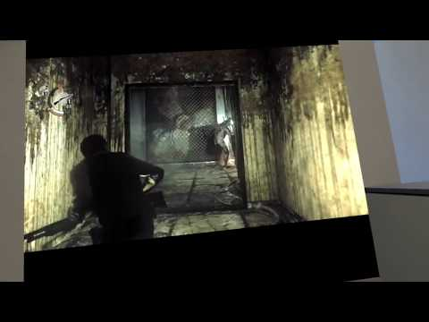 Playing The Evil Within in the cliff house