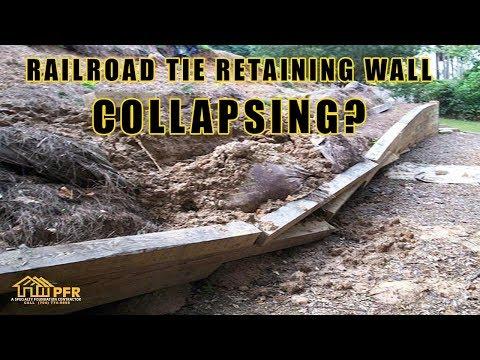 RAILROAD TIE RETAINING WALL COLLAPSING 704.787.6972 CHARLOTTE NC