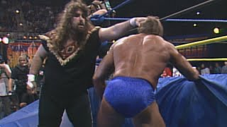 Cactus Jack brutalizes Paul Orndorff in a Falls Count Anywhere Match: WCW SuperBrawl III