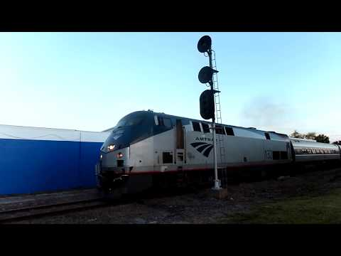 Amtrak Train Ready To Reverse Car Goes Around Gates