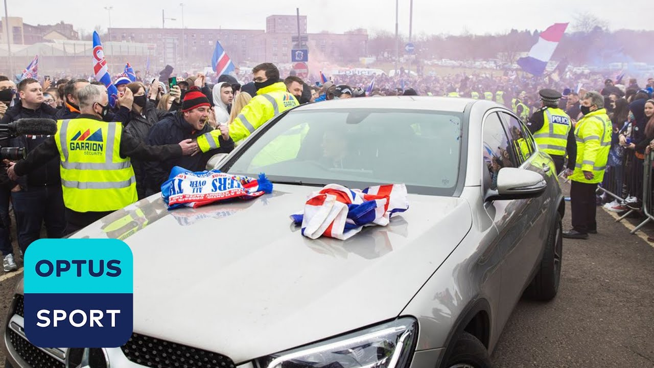WILD SCENES! Steven Gerrard's car mobbed by Rangers fans, policeman gets knocked down outside Ibrox