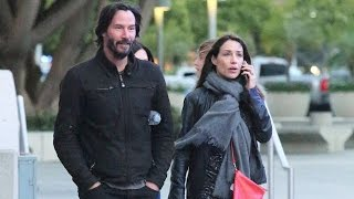 Wednesday, May 25, 2016 - Keanu Reeves and a cute mystery brunette arrive at the Staples Center in downtown Los Angeles for The Who