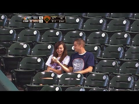 Fan makes catch to save girlfriend from foul ball