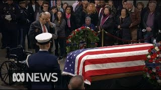 Bob Dole helped out of his wheelchair to salute George HW Bush | ABC News