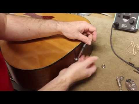 Acoustic end pin jack adjustment