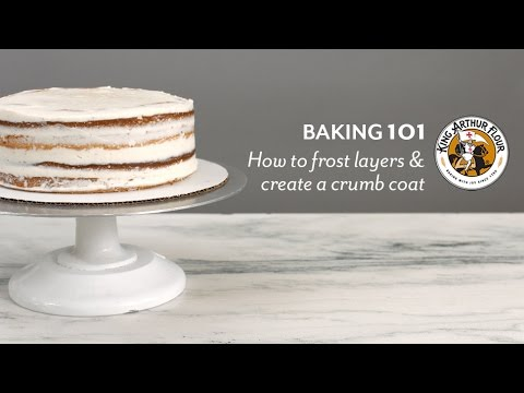 How to frost cake layers and create a crumb coat
