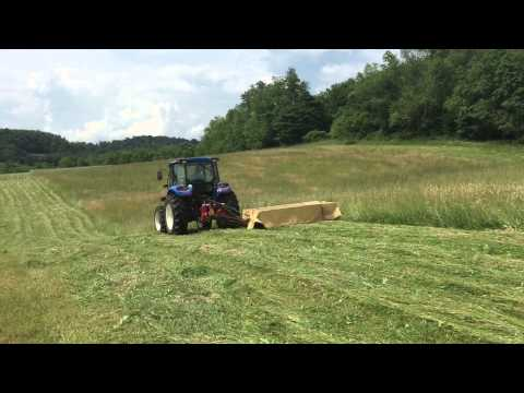 Mowing hay with New Holland 4.75 tractor