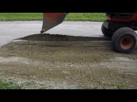 DIY -  How to fill potholes with a tractor.