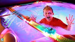 Longest Giant Magic Tracks Toy Car Chase Over Hot Tub!