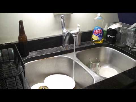 Reduction in water flow at kitchen sink faucet after running water.