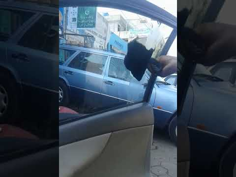 removing chewing gum bubble gum / adhesive from car glass window mirror with petrol in lahore