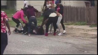 Mob Repeatedly Kicks and Stomps Woman in