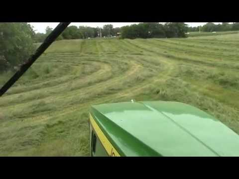 Cab View From a John Deere 7210R Tractor Mowing Hay