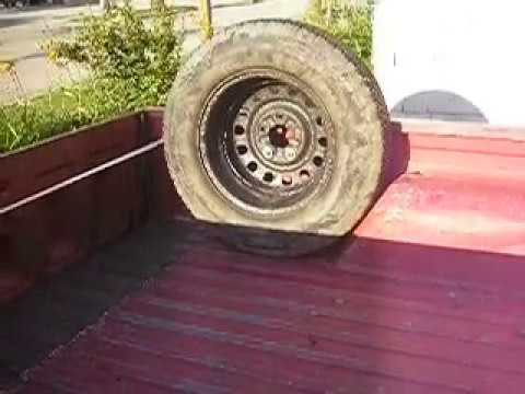 mounting the spare tire in the bed of a pickup