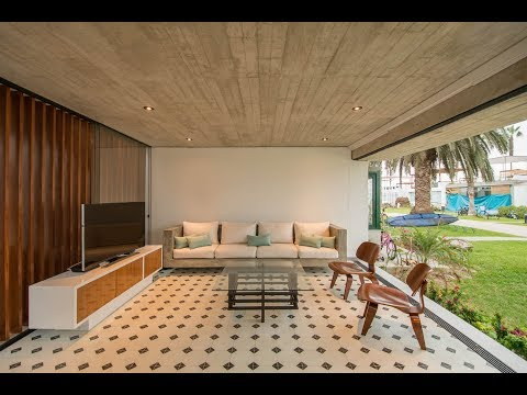 Modern Concrete Beach House Design with Rooftop Terrace