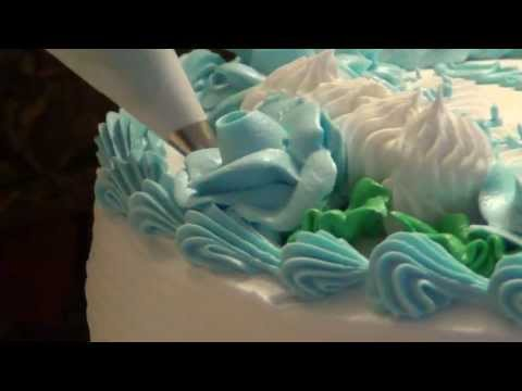A Baby Shower Cake with Booties! by CakesToYouTutorials.com