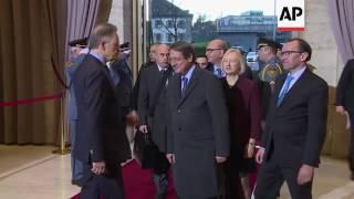 Greek, Turkish Cypriot leaders arrive in Geneva