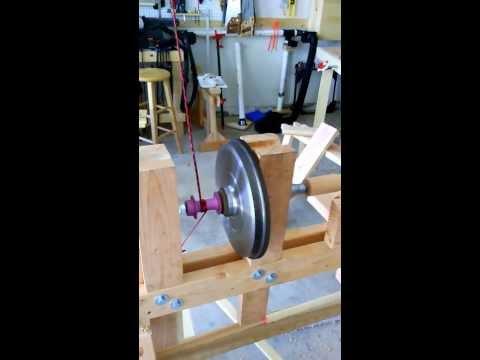 Pole/flywheel lathe