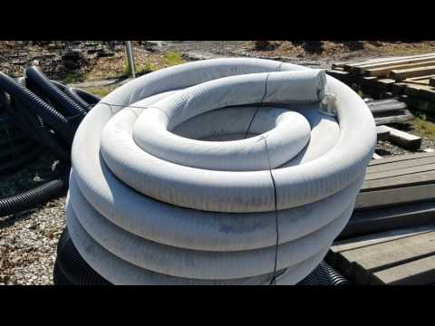Don't use a drain sleeve / pipe sock  with a French drain system in Michigan