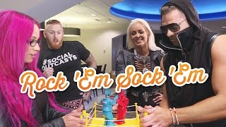 WWE Superstars play Rock