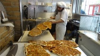 Master Baker Gino making Turkish Flat Bread Pizza (Pide) and Lamachun in a wood fired oven, London.