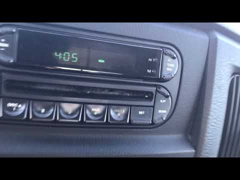 How To Set The Clock On A Factory Radio In A 2005 Ram 1500 Pickup Truck