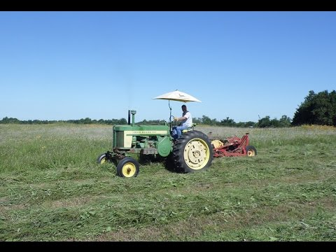 Mowing Native Prairie grass hay with a John Deere 720 Diesel Tractor