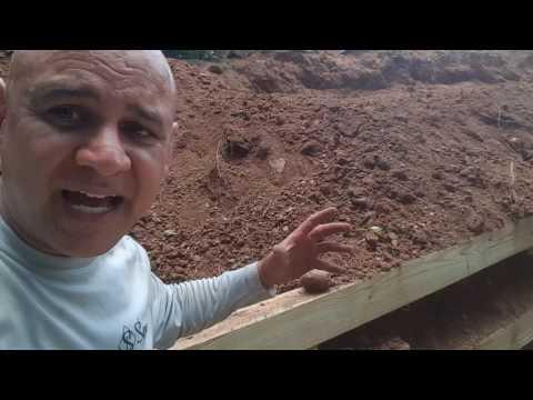 Timber retaining wall reinforcement