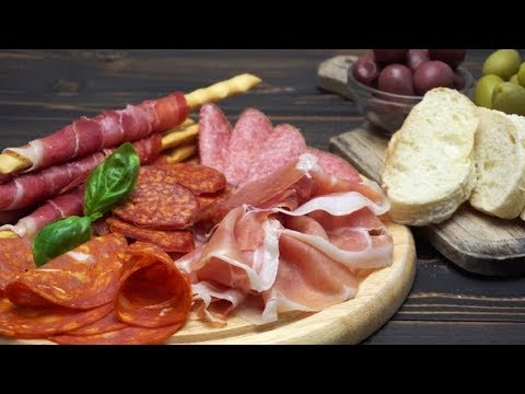 Video of Italian Meat Plate - Sliced Prosciutto, Sausage and Grissini | Stock Footage